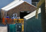 Migrants is seen in a military camp, where they are staying after being rescued by coast guards or reached the island by their own means, in Las Palmas