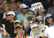 Supporters of Japan's Yoshihito Nishioka react after his win over Serbia's Laslo Djere in their first round singles match at the Australian Open tennis championship in Melbourne, Australia, Monday, Jan. 20, 2020. (AP Photo/Andy Brownbill)