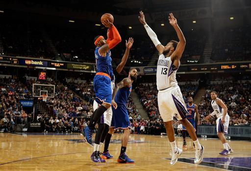 SACRAMENTO, CA - MARCH 26: Carmelo Anthony #7 of the New York Knicks shoots over Derrick Williams #13 of the Sacramento Kings at Sleep Train Arena on March 26, 2014 in Sacramento, California. (Photo by Ezra Shaw/Getty Images)