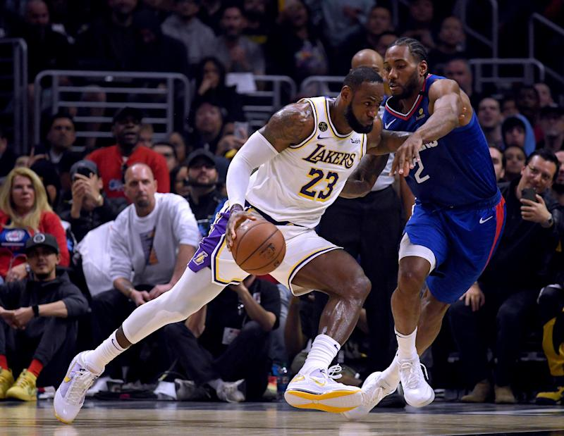 LOS ANGELES, CALIFORNIA - MARCH 08: LeBron James #23 of the Los Angeles Lakers drives to the basket on Kawhi Leonard #2 of the LA Clippers during the first half at Staples Center on March 08, 2020 in Los Angeles, California. NOTE TO USER: User expressly acknowledges and agrees that, by downloading and or using this photograph, User is consenting to the terms and conditions of the Getty Images License Agreement. (Photo by Harry How/Getty Images)