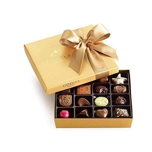 """<p><strong>Godiva Chocolatier </strong></p><p>amazon.com</p><p><strong>$41.10</strong></p><p><a href=""""https://www.amazon.com/dp/B00OPENQ80?tag=syn-yahoo-20&ascsubtag=%5Bartid%7C10063.g.35014712%5Bsrc%7Cyahoo-us"""" rel=""""nofollow noopener"""" target=""""_blank"""" data-ylk=""""slk:Shop Now"""" class=""""link rapid-noclick-resp"""">Shop Now</a></p><p>Belgian chocolate is famous for a reason, and so is Godiva. We don't know anyone who'd be disappointed to get a classic gold box filled with the chocolatier's signature flavors. </p>"""