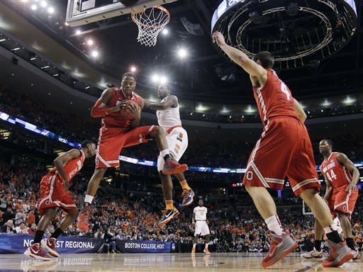 Ohio State forward Deshaun Thomas (1) grabs a rebound in front of Syracuse guard Dion Waiters (3) during the first half of the East Regional final game in the NCAA men's college basketball tournament, Saturday, March 24, 2012, in Boston. (AP Photo/Elise Amendola)