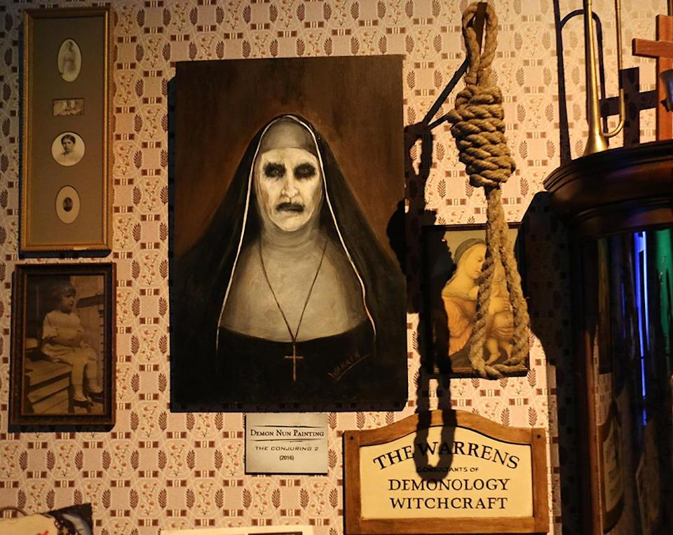 """<p>This is the painting of the demonic nun, who is <a rel=""""nofollow"""" href=""""https://www.yahoo.com/movies/conjuring-2-spinoff-the-nun-in-the-works-201055582.html"""" data-ylk=""""slk:getting her own spin-off movie;outcm:mb_qualified_link;_E:mb_qualified_link;ct:story;"""" class=""""link rapid-noclick-resp yahoo-link"""">getting her own spin-off movie</a>. The prop and the monster were last-minute additions to the film. (Photo: Angela Kim/Yahoo) </p>"""