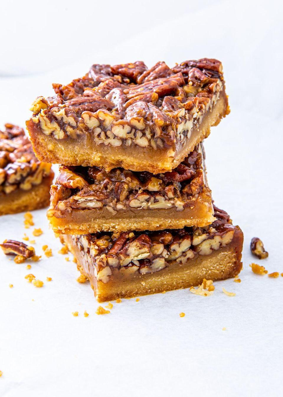 "<p>A handheld version of pecan pie? We're in! </p><p>Get the recipe from <a href=""https://www.delish.com/cooking/recipe-ideas/recipes/a44598/pecan-pie-bars-recipe-best-dessert-bars/"" rel=""nofollow noopener"" target=""_blank"" data-ylk=""slk:Delish"" class=""link rapid-noclick-resp"">Delish</a>.</p>"