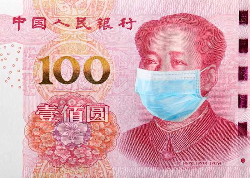 Concept of coronavirus 2019-nCoV quarantine in China. Yuan banknote with medical face mask.