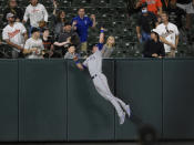 Texas Rangers left fielder DJ Peters makes a catch on a fly ball hit by Baltimore Orioles' Pat Valaika for an out during the fourth inning of a baseball game, Friday, Sept. 24, 2021, in Baltimore. (AP Photo/Nick Wass)