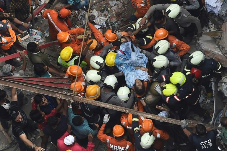 India's National Disaster Response Force help rescue a survivor from a collapsed building in Mumbai