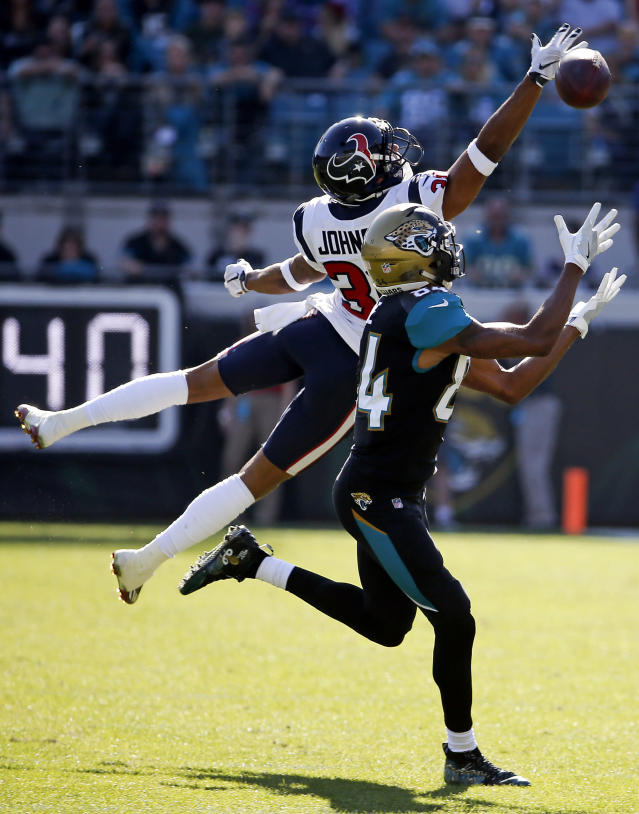 <p>Jacksonville Jaguars wide receiver Keelan Cole (84) makes a catch for a 32-yard gain in front of Houston Texans cornerback Kevin Johnson during the first half of an NFL football game, Sunday, Dec. 17, 2017, in Jacksonville, Fla. (AP Photo/Stephen B. Morton) </p>