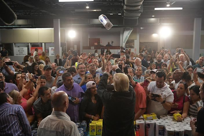 <p>OCT. 3, 2017 – President Donald Trump throws a paper towel roll as he visits the Cavalry Chapel in Guaynabo, Puerto Rico.<br> Nearly two weeks after Hurricane Maria thrashed through the US territory, much of the islands remains short of food and without access to power or drinking water. (Photo: Mandal Ngan/AFP/Getty Images) </p>