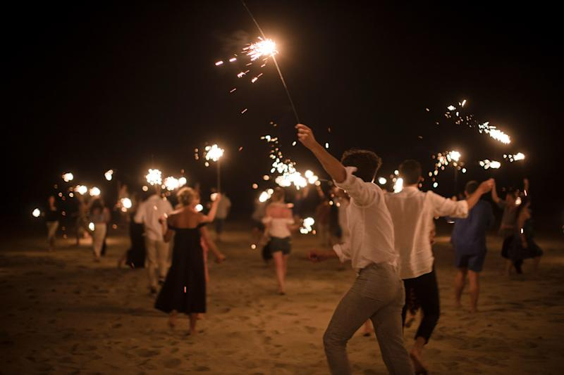 All of our guests running with sparklers on the beach outside Hotel Escondido.