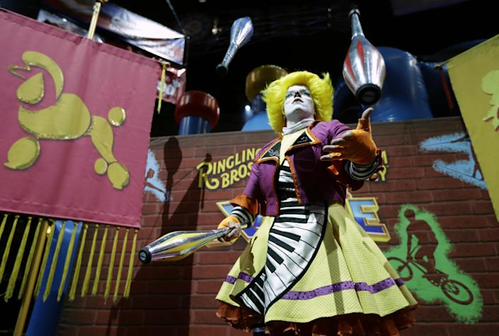 """A Ringling Bros. and Barnum & Bailey clown juggles for fans during a pre show for fans Saturday, Jan. 14, 2017, in Orlando, Fla. The Ringling Bros. and Barnum & Bailey Circus will end the """"The Greatest Show on Earth"""" in May, following a 146-year run of performances. Kenneth Feld, the chairman and CEO of Feld Entertainment, which owns the circus, told The Associated Press, declining attendance combined with high operating costs are among the reasons for closing. (AP Photo/Chris O'Meara)"""