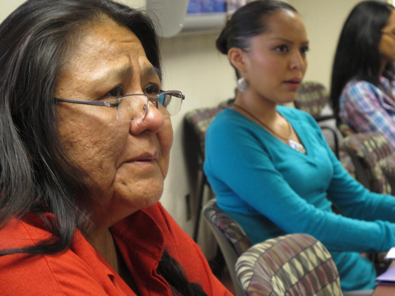 In this Oct. 19, 2012 photo, activist Donna House, 58, of Ohkay Owingeh Pueblo, left, participates in a forum on access for American Indian women getting emergency contraceptive Plan B, in Albuquerque. The federal Indian Health Services has said it is finalizing a policy to make Plan B available to American Indian women at its facilities much like it is in retail pharmacies across the country — without requiring a consultation with a health care provider and without a prescription, except for those under 17.  (AP Photo/Russell Contreras)