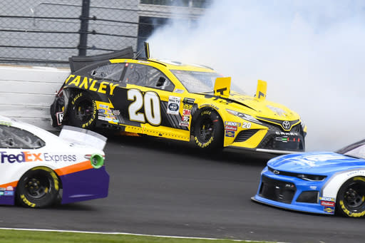 NASCAR driver Erik Jones hits the wall in the second turn during the NASCAR Brickyard 400 auto race at Indianapolis Motor Speedway, Sunday, Sept. 8, 2019, in Indianapolis. (AP Photo/Greg Huey)