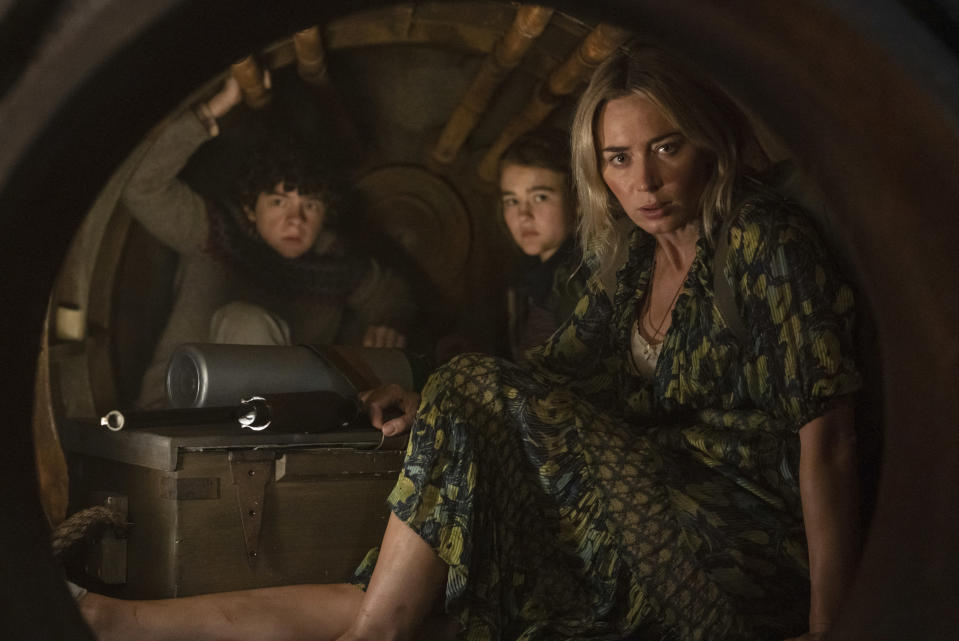 """This image released by Paramount Pictures shows, from left, Noah Jupe, Millicent Simmonds and Emily Blunt in a scene from """"A Quiet Place Part II."""" (Jonny Cournoyer/Paramount Pictures via AP)"""