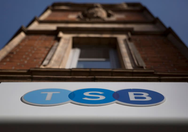 FILE PHOTO: A sign is displayed outside a branch of the TSB bank in central London