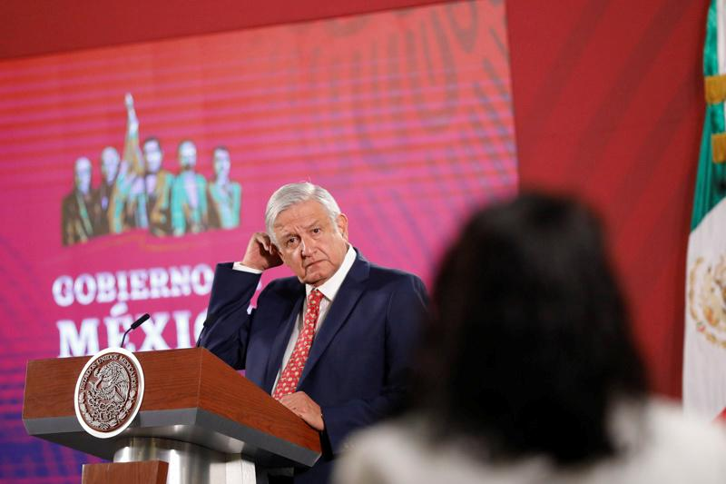 Mexico's President Andres Manuel Lopez Obrador gestures as he answers questions during his daily news conference at National Palace in Mexico City, Mexico February 14, 2020. REUTERS/Carlos Jasso