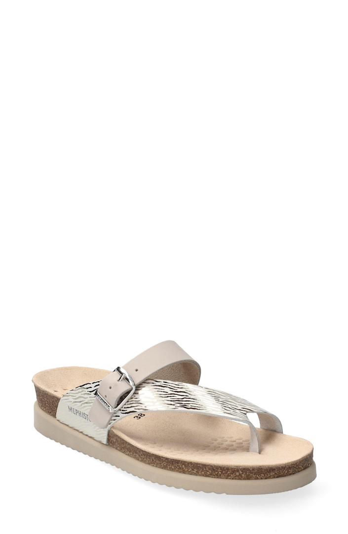 """<p><strong>Mephisto</strong></p><p>nordstrom.com</p><p><strong>$148.95</strong></p><p><a href=""""https://go.redirectingat.com?id=74968X1596630&url=https%3A%2F%2Fwww.nordstrom.com%2Fs%2Fmephisto-helen-mix-sandal-women%2F4612571&sref=https%3A%2F%2Fwww.thepioneerwoman.com%2Ffashion-style%2Fg35524011%2Fcomfortable-flip-flops%2F"""" rel=""""nofollow noopener"""" target=""""_blank"""" data-ylk=""""slk:Shop Now"""" class=""""link rapid-noclick-resp"""">Shop Now</a></p><p>These flip flops look stylish thanks to their metallic calfskin straps, but they're also practical! They have a 1-inch Soft Air footbed that helps with shock absorption.</p>"""