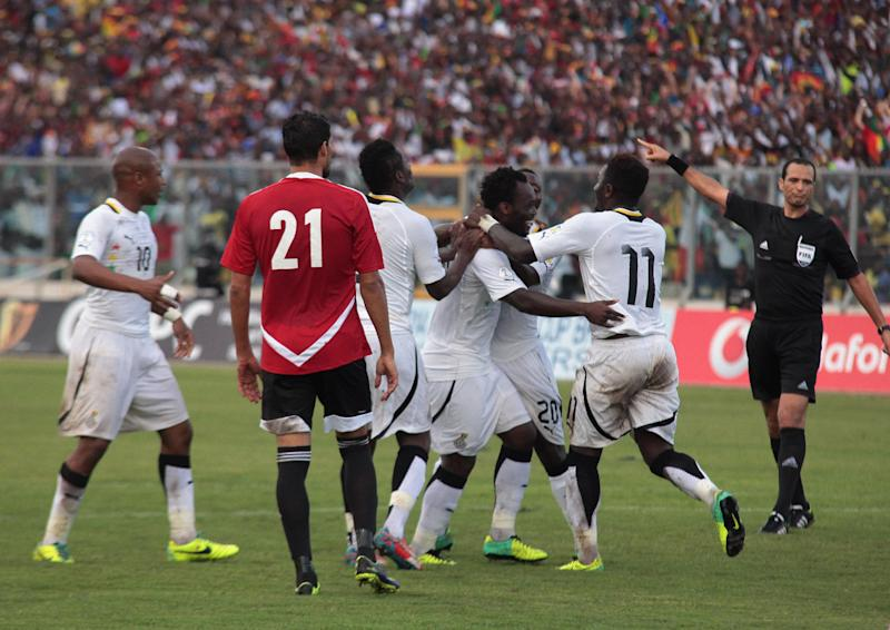 Ghana players celebrate a goal during their World Cup playoff soccer match in Kumasi, Ghana, Tuesday, Oct. 15, 2013. Ghana stunned Egypt 6-1 in the first leg of their World Cup playoff on Tuesday, with Gyan's fifth-minute goal kicking off a dominant performance that makes the Black Stars overwhelming favorites to be one of the five African teams in Brazil next year. (AP Photo)