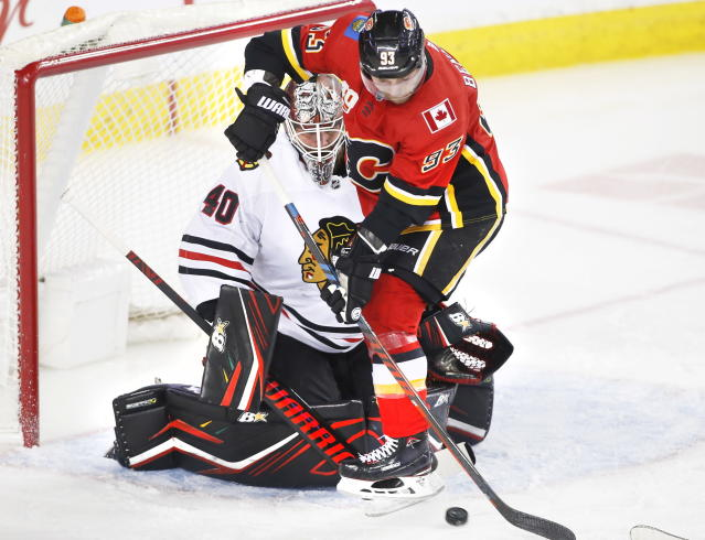 Chicago Blackhawks goalie Robin Lehner (40) from Sweden, makes a save against Calgary Flames centre Sam Bennett (93) during first-period NHL hockey game action in Calgary, Alberta, Saturday, Feb. 15, 2020. (Larry MacDougal/The Canadian Press via AP)