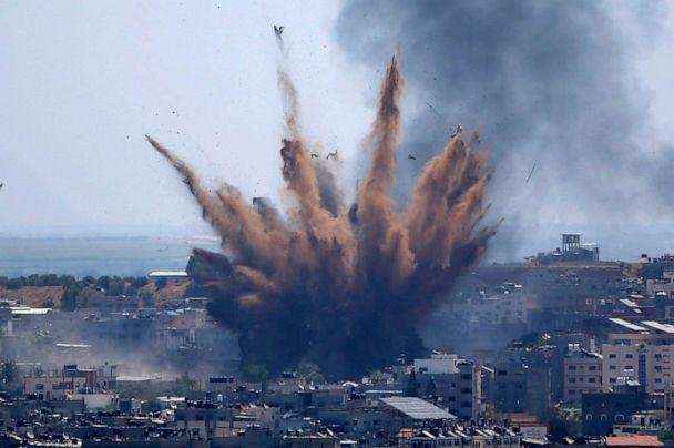 PHOTO: Smoke rises following Israeli airstrikes on a building in Gaza City, May 13, 2021. (Hatem Moussa/AP)