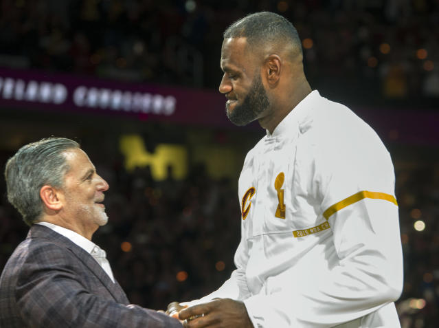 "Cavaliers owner Dan Gilbert presents <a class=""link rapid-noclick-resp"" href=""/nba/players/3704/"" data-ylk=""slk:LeBron James"">LeBron James</a> with his 2016 championship ring. (AP)"