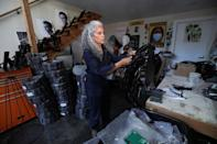 """Sculptor Dana King works on a piece for an upcoming exhibit titled """"Monumental Reckoning"""" while at her studio in Oakland"""