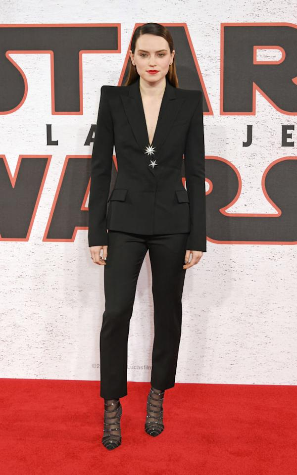 <p>Dern isn't the only <em>Star Wars</em> star who can rock a power suit. Daisey Ridley feminizes a black suit with a plunging neckline and slinky stilettos. (Photo by David M. Benett/Dave Benett/WireImage) </p>