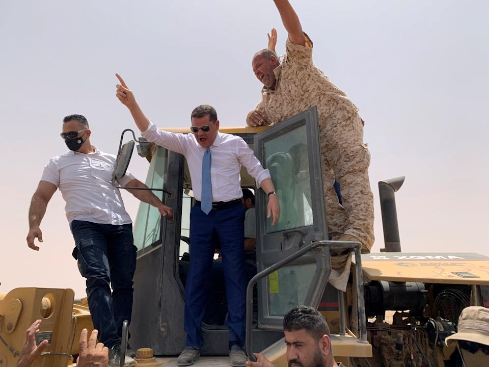 Libyan Prime Minister Abdulhamid Dbeibeh gestures during the re-opening of the cross road across the frozen frontline between east and west in Libya, June 20, 2021. REUTERS/Ayman al-Sahili