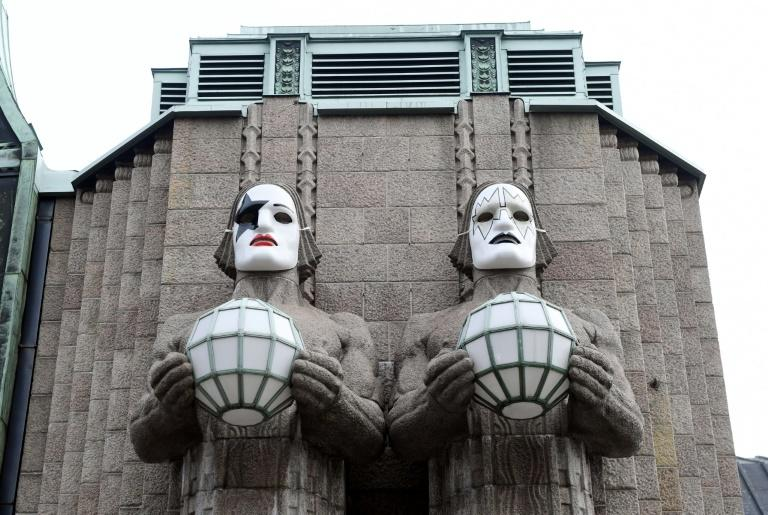 Statues painted with masks in tribute to rock band KISS at Helsinki's central station, pictured on April 28, 2017