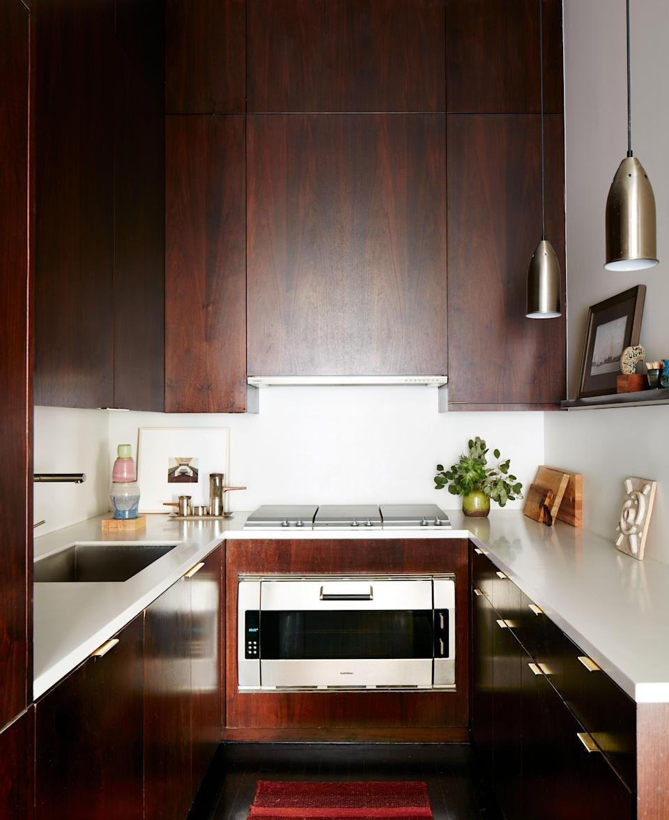 When Otero first saw the apartment, it had very low ceilings, so he opened everything and made the cabinets in the kitchen go all the way up, giving an element of drama plus handy added storage. The countertops are made of Corian; the brass pulls are from Wainlands; the cooktop and oven are from Gaggenau; and the faucet is from Blanco.