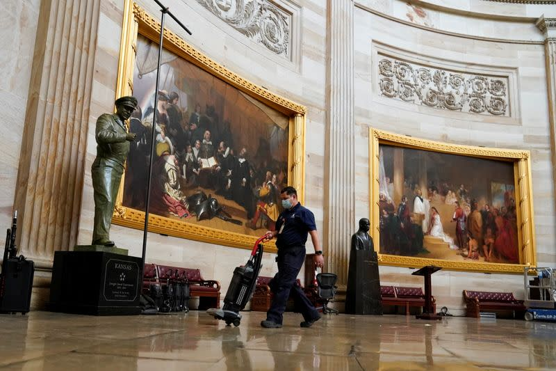 Workers setup lights in the Capitol rotunda ahead of U.S. President-elect Joe Biden's inauguration