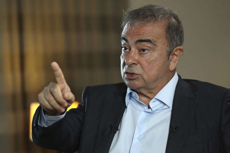 Former Nissan executive Carlos Ghosn speaks during an interview with the Associated Press, in Dbayeh, north of Beirut, Lebanon, Tuesday, May 25, 2021. Lebanese judicial officials say a team of French investigators have begun questioning Ghosn in Beirut Monday, May 31, 2021, over suspicions of misconducts. (AP Photo/Hussein Malla)