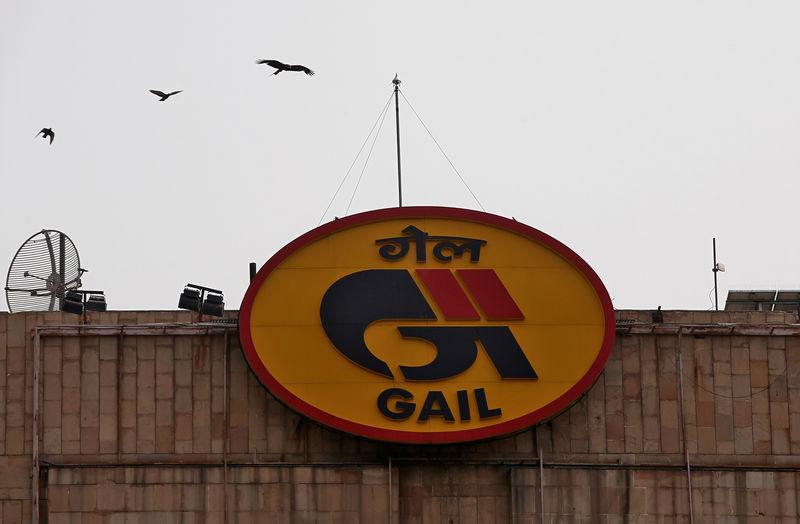 Birds fly past the logo of India's state-owned natural gas utility GAIL (India) Ltd in New Delhi