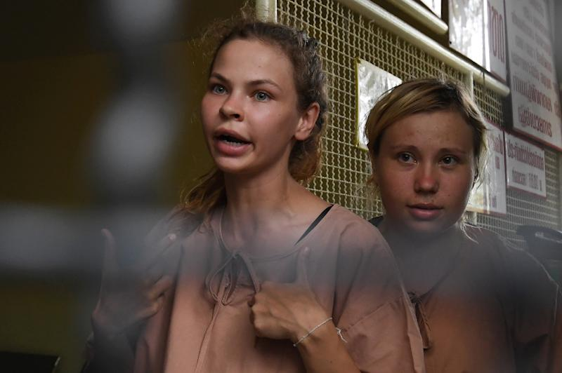Anastasia Vashukevich, pictured left with another unidentified detainee in Thailand, has claimed to know secrets about alleged Russian meddling in the 2016 US election