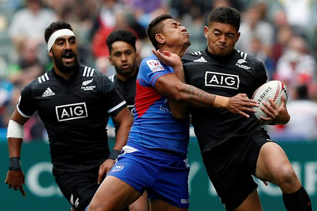 Rugby Union - Hong Kong Sevens - New Zealand v Samoa - Hong Kong Stadium, Hong Kong, China - April 7, 2018 New Zealand's Tone Ng Shiu (R) is tackled. REUTERS/Bobby Yip