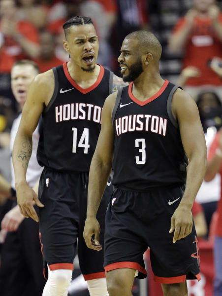 Houston Rockets guard Chris Paul (3) celebrates a score with teammate Gerald Green (14) during the first half in Game 2 of the NBA basketball Western Conference Finals against the Golden State Warriors, Wednesday, May 16, 2018, in Houston. (AP Photo/David J. Phillip)