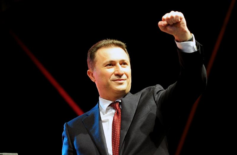 Macedonian Prime Minister Nikola Gruevski raises his fist during a rally in the centre of Skopje on May 18, 2015