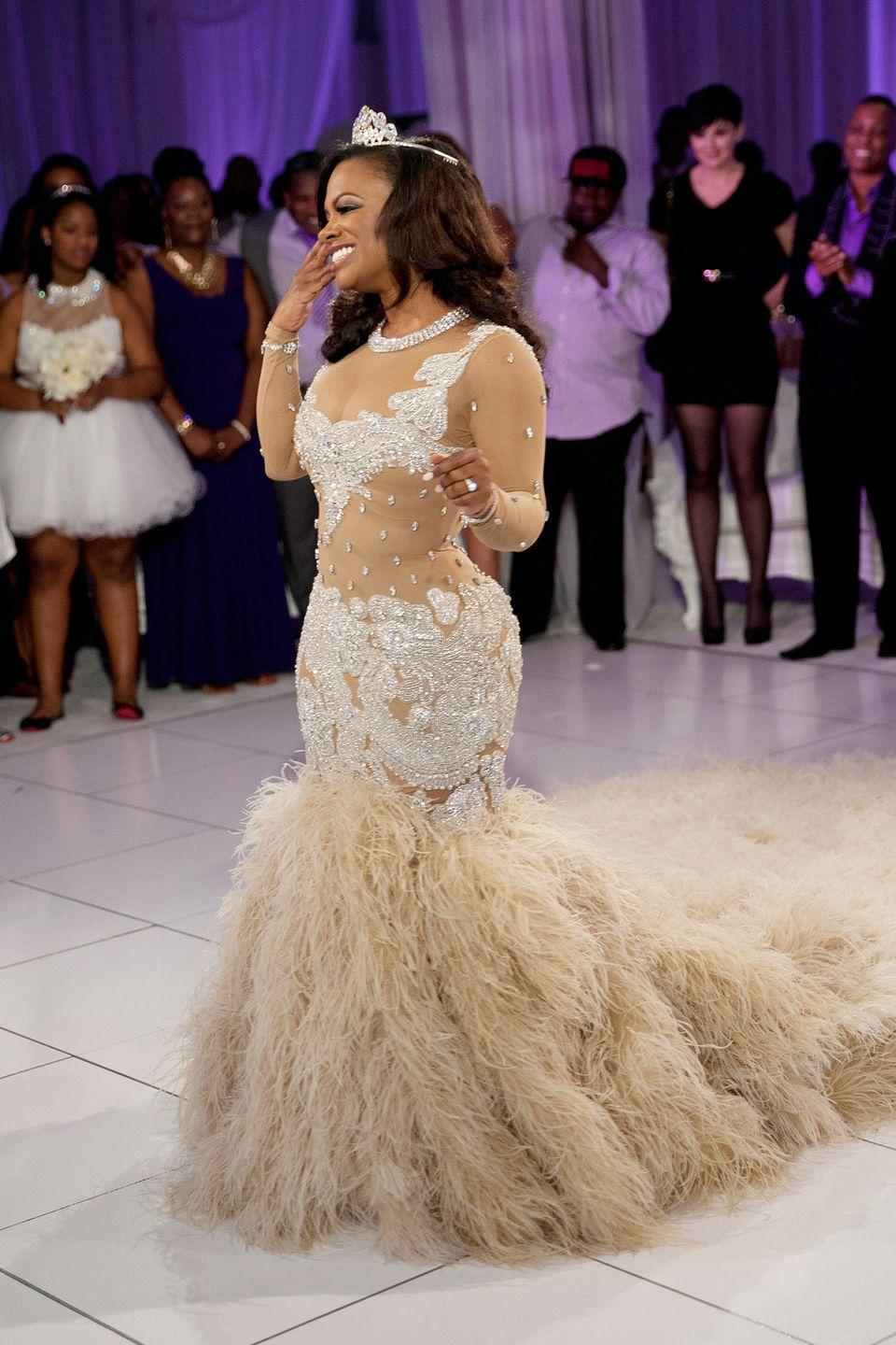 <p>As for Kandi Burruss, another <em>Real Housewives of Atlanta </em>star, there's no surprise here that she didn't hold back for her wedding to Todd Tucker. Her custom Reco Chapple dress reportedly cost $20,000 and featured a 12-foot ostrich feather train.</p>