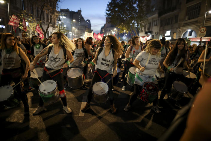 "Women play drums during a protest against gender violence in Buenos Aires, Argentina, Monday, June 3, 2019. The grassroots movement ""Ni una menos,"" or Not One Less, is marking its fourth anniversary by remembering the hundreds of women who have been murdered since its founding, and demanding laws to curb sexist violence that continues to permeate Argentine society. (AP Photo/Natacha Pisarenko)"