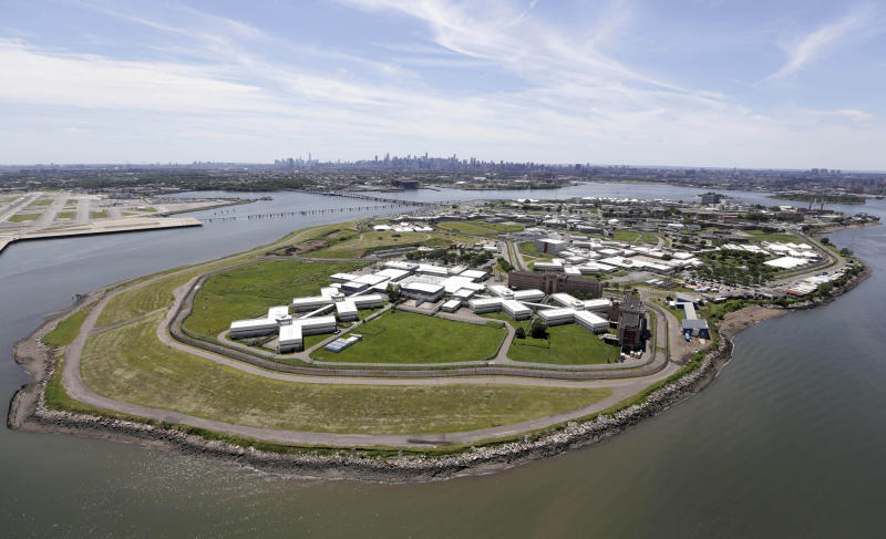 FILE - In this June 20, 2014, file photo, New York City's Rikers Island jail complex, center, is seen with LaGuardia Airport on the upper left, and the Manhattan skyline in the background at center. A commission urging the city to close the massive jail complex says an option for reusing the space could be a new runway and terminal extension of LaGuardia Airport, which last year had by far the highest rate of late-arriving flights of any of the nation's 29 biggest airports.  (AP Photo/Seth Wenig, File)