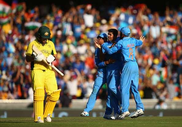 SYDNEY, AUSTRALIA - MARCH 26: Umesh Yadav of India celebrates after taking the wicket of Aaron Finch of Australia during the 2015 Cricket World Cup Semi Final match between Australia and India at Sydney Cricket Ground on March 26, 2015 in Sydney, Australia. (Photo by Ryan Pierse/Getty Images)