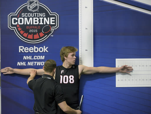 FILE - In this June 6, 2015, file photo, Connor McDavid participates in the wingspan measurement during the NHL Scouting Combine in Buffalo, N.Y. The NHL's top prospects will continue making their pre-draft stop in Buffalo for at least another three years, The league on Monday, Jan. 13, 2020, announced it has extended its agreement to hold its annual scouting combine in Buffalo at the Sabres downtown practice facility, LECOM Harborcenter, through 2022. (AP Photo/Gary Wiepert, File)