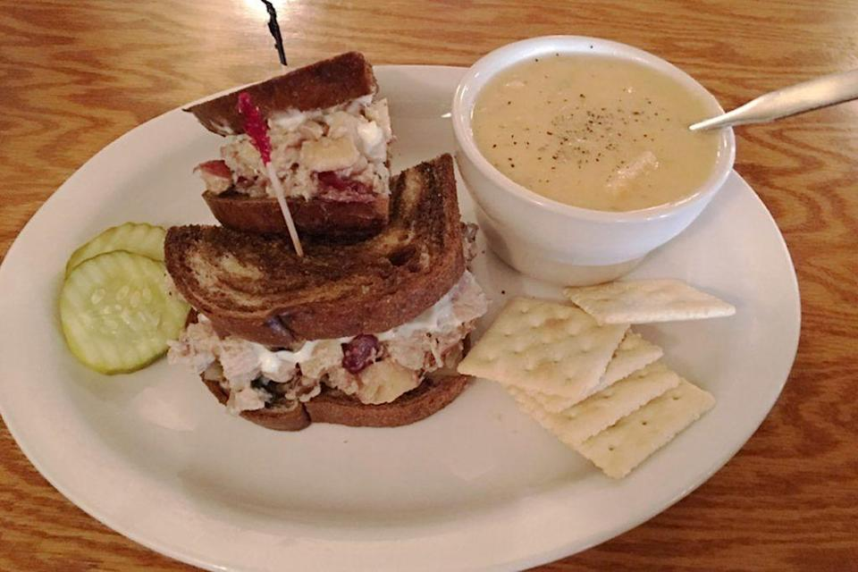 """<p><strong>Pheasant Salad Sandwich</strong></p><p>South Dakota has been known for the pheasant salad sandwiches since World War II, when volunteers gave the local sandwich to soldiers for free. You can get one at <a href=""""https://pheasantrestaurant.com/"""" rel=""""nofollow noopener"""" target=""""_blank"""" data-ylk=""""slk:Pheasant Restaurant"""" class=""""link rapid-noclick-resp"""">Pheasant Restaurant</a>. Since then the sandwich hasn't changed, a sandwich of pheasant, pecans, cranberries and Swiss cheese on toasted rye bread. </p>"""