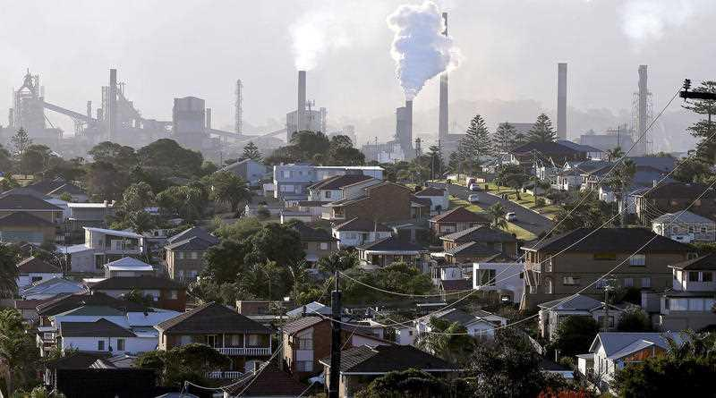 Gas billows from chimneys at a steel factory in Port Kembla, south of Sydney.