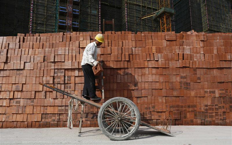A labourer works at a construction site in Hangzhou