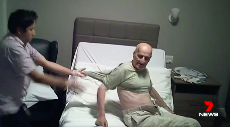 Shocking footage shows David Nabulsi being manhandled by a nurse his family trusted with his care. Source: 7News