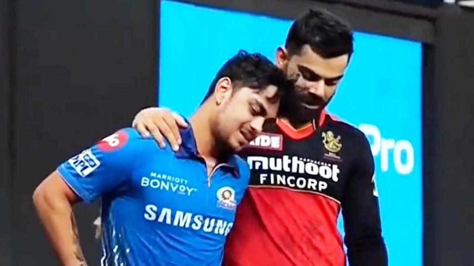 Virat Kohli (pictured right) embraces Ishan Kishan (pictured right) for a chat after the game.