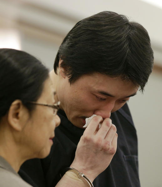 Xiao Ye Bai reacts as he reads a statement to the court during his sentencing, Tuesday, March 5, 2013, in Las Vegas. The 26-year-old Chinese immigrant, convicted of being an enforcer for a Taiwan-based criminal gang, will spend the rest of his life in a Nevada prison for killing one person and wounding two others in a bloody knife attack in a Las Vegas karaoke bar in July 2009. (AP Photo/Julie Jacobson)