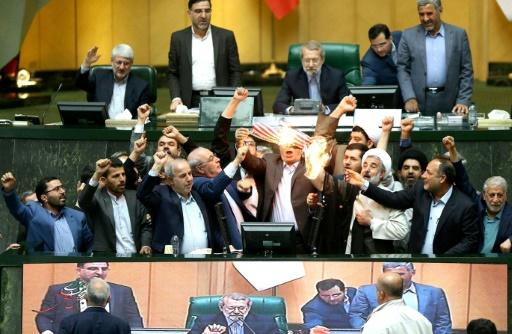 Iranian MPs burn a US flag in parliament in Tehran on May 9, 2018