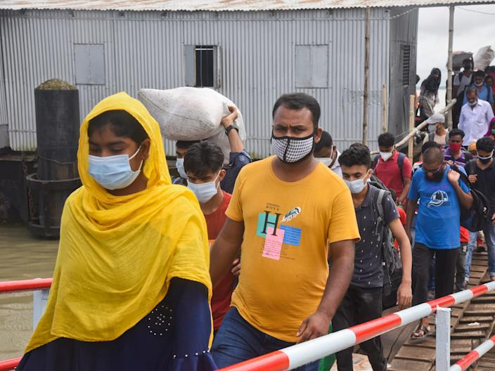 """People wearing facemasks arrive at Launch station in the River Padma in Dhaka, Bangladesh on August 5, 2020. <p class=""""copyright"""">Mamunur Rashid/NurPhoto via Getty Images</p>"""